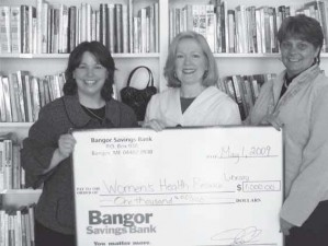 Pictured Sheryl Edgecomb, Bangor Savings Bank; Chris Kuhni, WHRL Executi ve Director; and Rose White, Bangor Savings Bank.