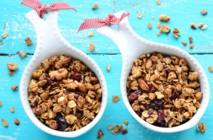 Homemade granola on wooden turquoise background