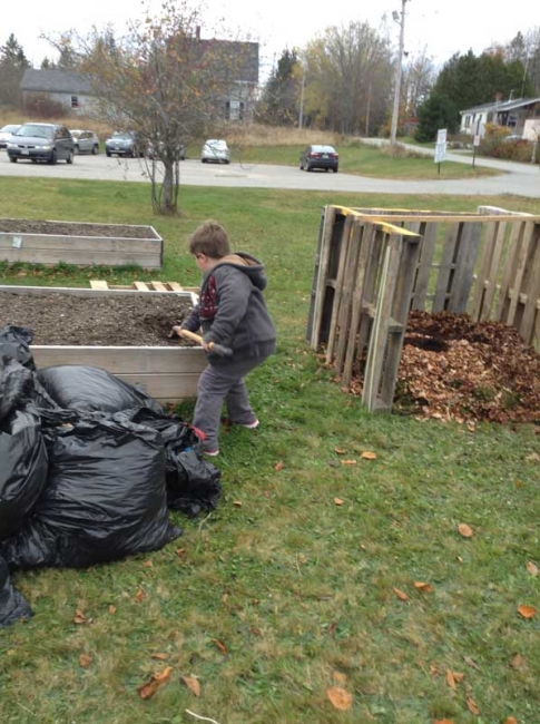A little bit of soil from the garden to make the compost feel right at home.  There were many willing and enthusiastic workers.