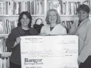 Pictured Sheryl Edgecomb, Bangor Savings Bank; Chris Kuhni, WHRL Executi ve Director; and Rose White, Bangor Savings Bank.