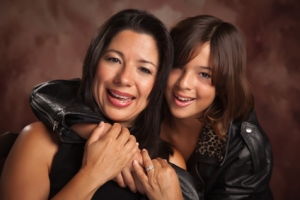Attractive Hispanic Mother and Daughter Studio Portrait.