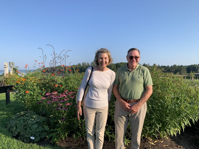 Man and Woman in front of garden smiling